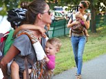 Supermom! Gisele Bundchen effortlessly carries both her children during family day at the park