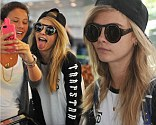 Cara Delevingne is seen landing at Heathrow Airport with a friend today in London