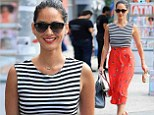 Olivia Munn is the height of chic in flouncy orange skirt and crop top during solo city stroll