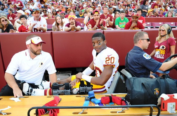 Redskins punt returner Richard Crawford leaves the field on a stretcher after suffering a season-ending knee injury during a preseason game against the Buffalo Bills.