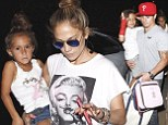 Talk about coordinated! Jennifer Lopez and daughter Emme wear identical top knots as son Max sports red arm cast to match Casper Smart's hat