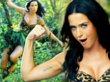 Queen of the jungle! Katy Perry takes a swing through the wild side sporting a plunging leopard-print bikini in new Roar video