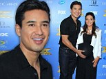 Any day now! Mario Lopez the doting dad caresses pregnant wife Courtney's very big bump at X Factor season three premiere