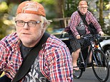 Working those pounds Hoff, man? Philip Seymour glows with health as he cycles up a storm in Manhattan