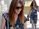 The perfect fit! Alyson Hannigan flashes a smile as she picks up her new engagement ring for upcoming vow renewals