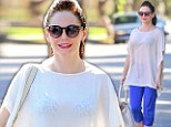 Flirty at 40! Birthday girl Rose McGowan celebrates her youthful figure in sheer top and leopard print bra