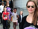 Something to smile about! Angelina Jolie touches down in Sydney with her six-strong brood to news of honorary Oscar award