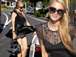 Socialite Paris Hilton looks sassy and stylish while out shopping at Open Ceremony and Book Soup in West Hollywood.