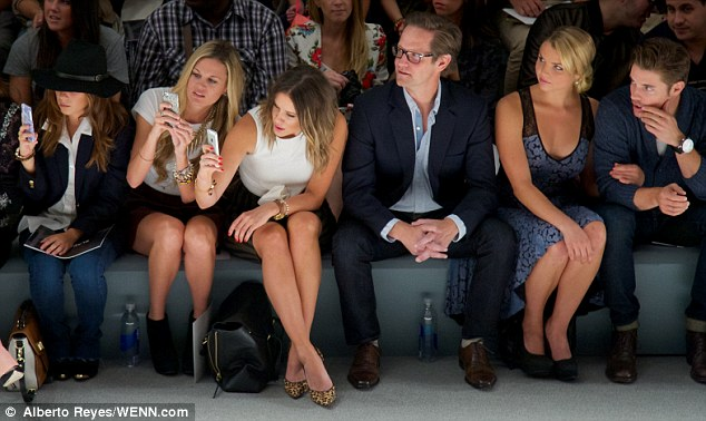 Take a picture, it lasts longer: The gals seated further down from Josh and Andrea captured the moment via their iPhones