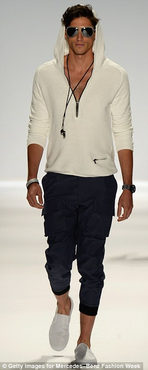 Nautical style: One male model sported a zipper hoodie and pocketed trousers while another sported a black shirt with khaki trousers
