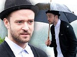 Singing in the rain! Justin Timberlake braves a miserable Moscow day to promote his new film Runner, Runner