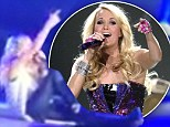 That's gotta hurt: Carrie Underwood takes a nasty tumble onstage in Texas resulting in a one very big cast on her foot