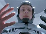 If the glove fits: Joel Kinnamon reprising the role of police officer Alex Murphy gets a first look at his robotic body as RoboCop in a new trailer for the film released on Thursday