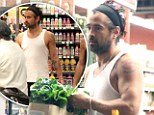 Not such a tough guy now! Colin Farrell shops for organic lettuce at Whole Foods while sporting his favourite headband