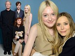 Dakota Fanning cosies up to pal Elizabeth Olsen before joining the cast of The Last Of Robin Hood for their official TIFF portrait