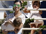 Raring to go! Penelope is on the move as Kourtney Kardashian takes her to Malibu beach for a playdate with friends