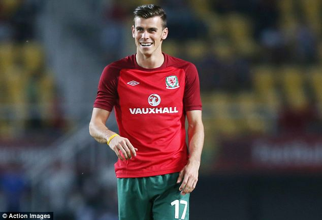 Missing in action: Bale failed to come on and Wales crashed to 2-1 defeat