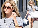 Ashley Tisdale flaunts her legs in a white hot mini-skirt as she shops in Beverly Hills
