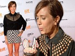 Happy Birthday! Kristen Wiig shows off tanned and toned legs as she celebrates the big 4-0 with a cupcake on the red carpet