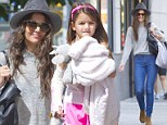 Girls' day out: Suri Cruise shows off her plaster cast as she enjoys a New York stroll with mom Katie Holmes