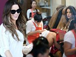 Pamper session! Kate Beckinsale flaunts her yoga-toned pins in black shorts for spa pedicure
