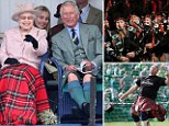 Prince Philip, Duke of Edinburgh, Queen Ellizabeth and Prince Charles, Prince of Wales laugh as they watch the sack race during the annual Braemer Highland Games
