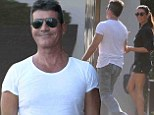 'Happier than ever' Simon Cowell steps out with ex-fiancée Mezhgan Hussainy... as it's revealed his baby with Lauren Silverman will be 'born in the UK'
