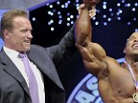 Passing the torch: Arnold Schwarzenegger raises the hand of current Mr. Olympia Phil Heath in upcoming documentary Generation Iron