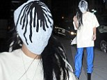 Hiding something? Lady Gaga wears mask and teeters on high heels outside her New York City apartment building