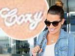 Lea Michele holds Cory Monteith close to her heart with tribute necklace as she jets into New York for first time since his death