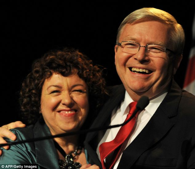 Defeated: Australian Prime Minister Kevin Rudd with his wife Therese Rein after he conceded defeat at a Labor party function in Brisbane