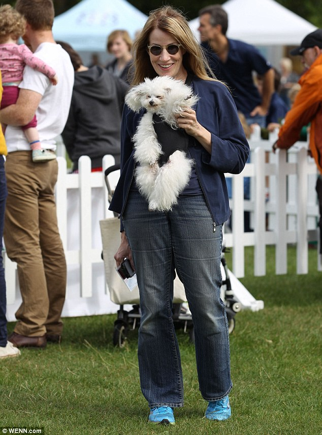 Pups galore: One visitor carries her cute dog as she looks around the stalls