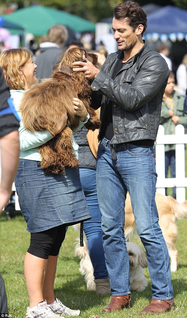 The 33-year-old chats to visitors and meets their canine friends as he judges the annual dog show