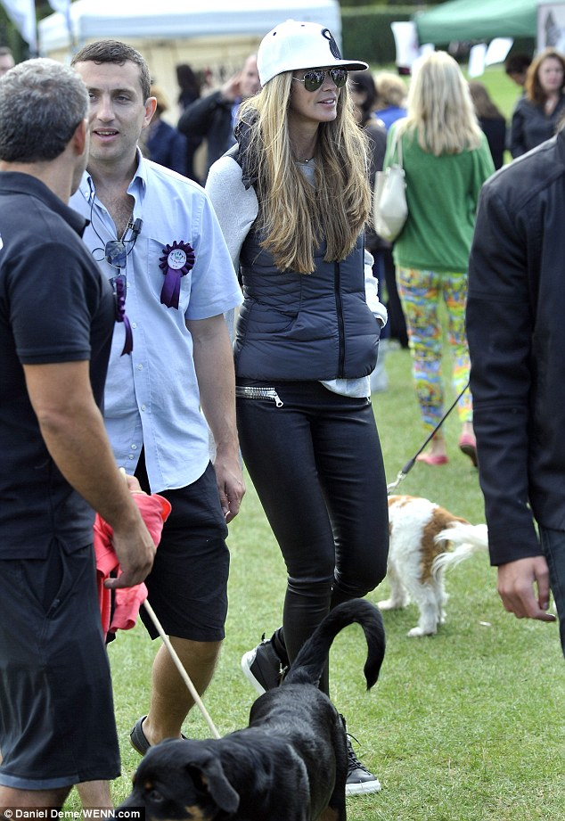 Despite her casual attire, Elle Macpherson looked every inch the supermodel as she walked about the park