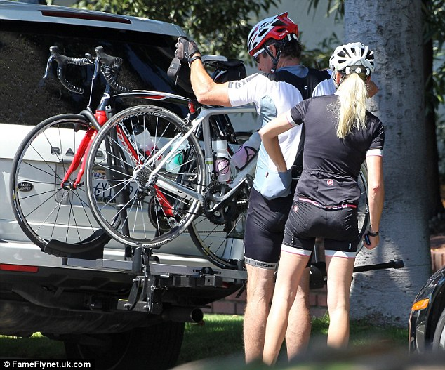 Loading up: They even co-ordinate3d their cycle gear in matching cycling shorts, helmets and trainers