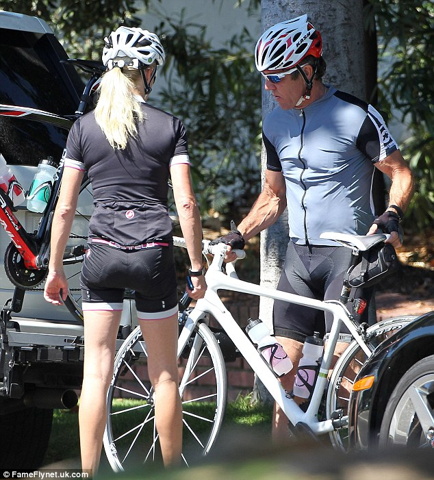 Going strong once more: Dennis and Kimberly were spotted cycling around Brentwood together on Friday as the news was revealed