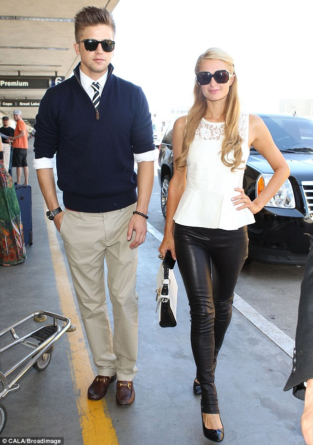 Polished pair: While Paris donned a feminine white lace accented peplum top, River wore a very preppy look