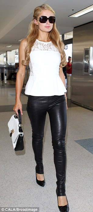 Flight gear: The 32-year-old donned super tight leather leggings which clung to her slim legs and finished over her ankles, tucking into her patent leather pumps