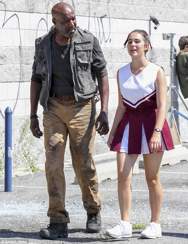 Star studded: Delroy Lindo was also seen looking grubby as he chatted to his castmates