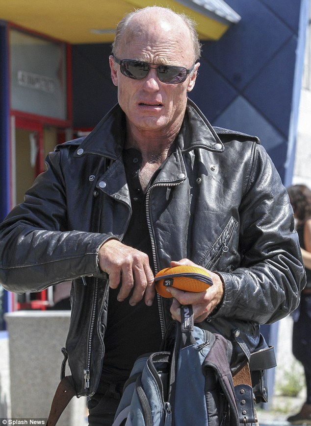 Biker boy: Ed Harris was also seen on set rocking a leather jacket and sunglasses
