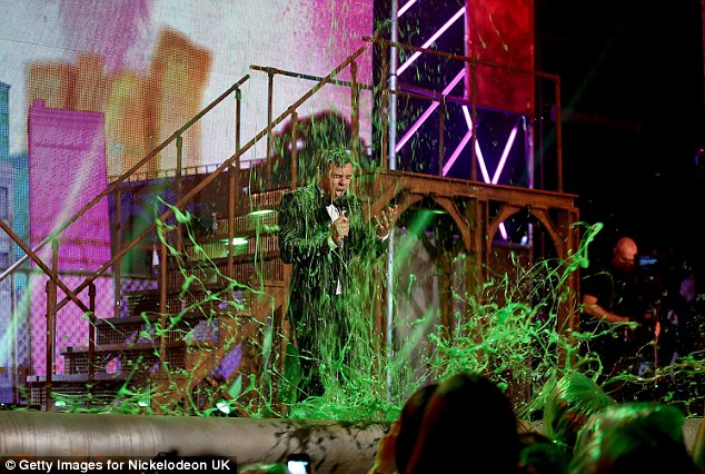 Tom gets covered in green slime, much to the audience's delight
