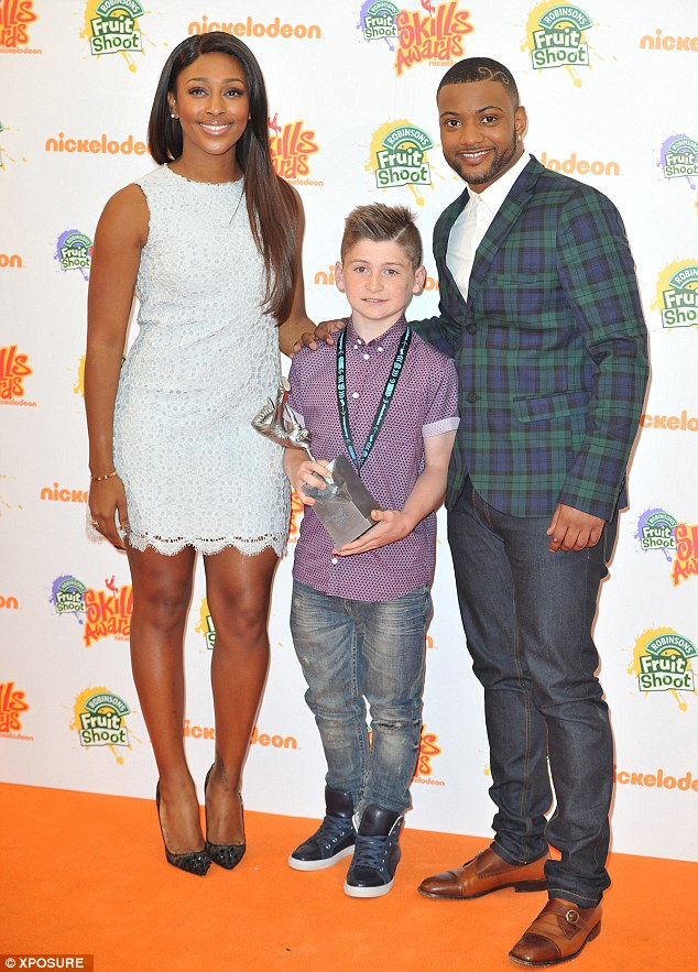 Alexandra and JLS star Oritse Williams pose for a photo with one of the day's award winners