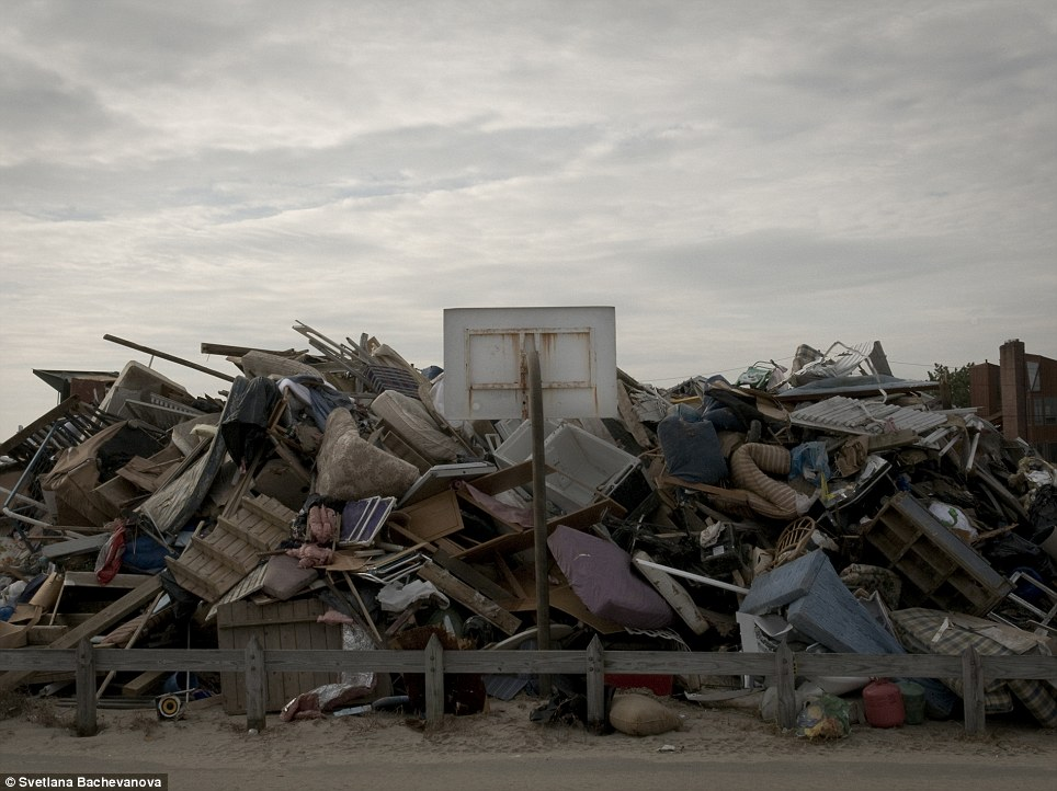 Piles of rubble: Debris from a house destroyed during Hurricane Sandy stored next to a basketball hoop in the beachfront community of Breezy Point