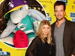 Their 'first parenting compromise': Josh Duhamel Instagram's pic of son Axl's allegiance to he and Fergie's favorite football teams