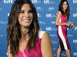 Sandra Bullock wears hot pink frock in Toronto and admits she 'didn't feel worthy' of her Oscar