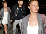LeAnn Rimes shows off her tanned legs in a white minidress as she and husband Eddie Cibrian jet to the UK to continue her tour