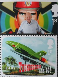 Gerry Anderson poses with a Thunderbirds stamp