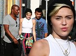 Smoke out! Miley Cyrus spends over 7 hours in a coffee shop in Amsterdam chilling out with friends... only to get mobbed by fans in Paris the next day