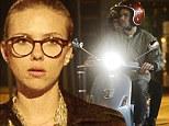 Love on wheels: Scarlett Johansson hops on fiancé Romain Dauriac's scooter after dinner date in Paris