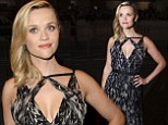 Don't move! Reese Withspoon remains perfectly poised as she tries to avoid a wardrobe malfunction